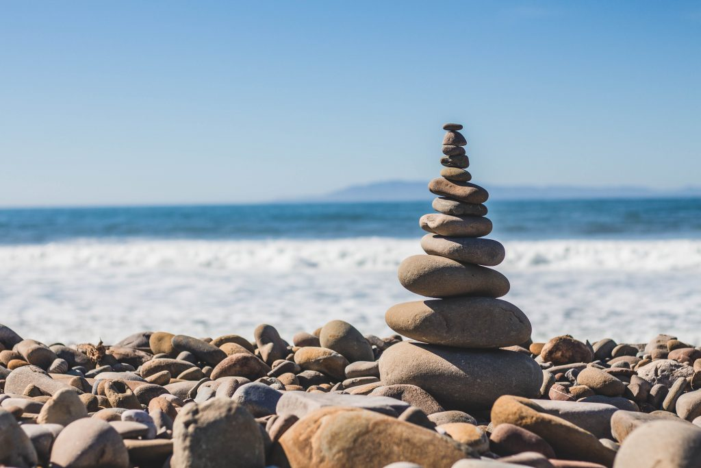 stacking rock in front of the ocean