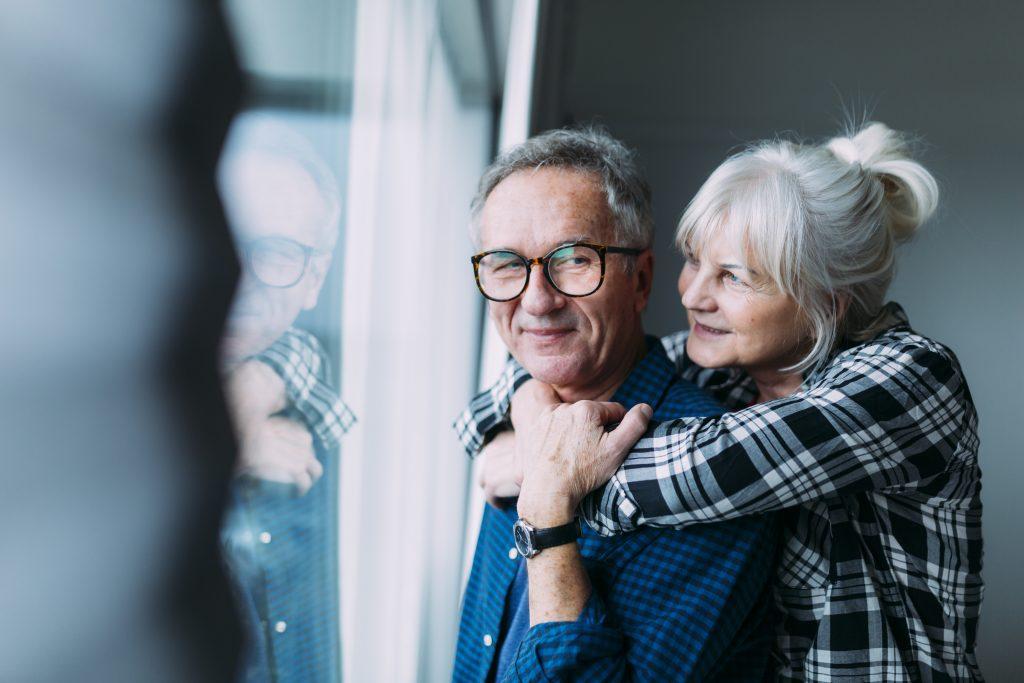 two elder couple near window