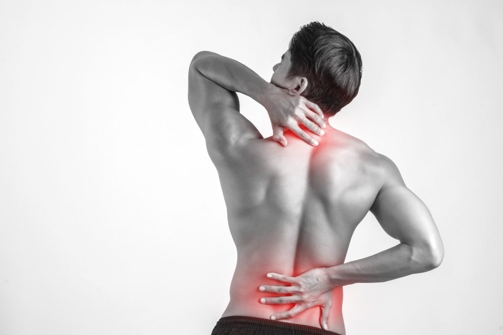a man touch spots on his back indicating back pains