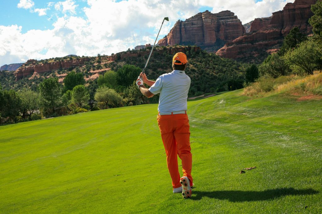 man golfing in the valley